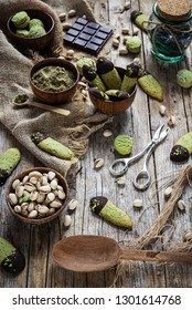 biscuits and pastries with pistachios and chocolate - rustic setting
