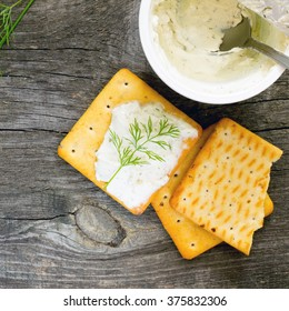 Biscuits salty crackers, dill and cream cheese, top view