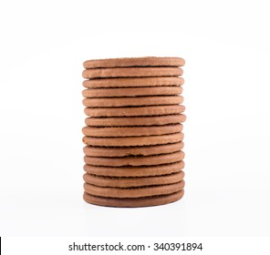 BISCUITS - A stack of delicious round biscuits with a few crumbs isolated on white
