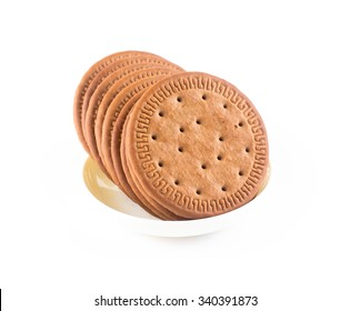 BISCUITS - A stack of delicious  round biscuits in white bowl with a few crumbs isolated on white