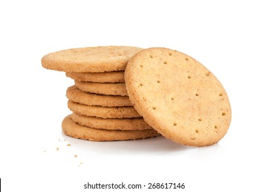 BISCUITS - A stack of delicious wheat round biscuits with a few crumbs isolated on white