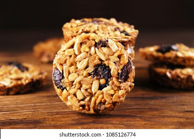 Biscuits from sunflower and sesame seeds on a wooden background.