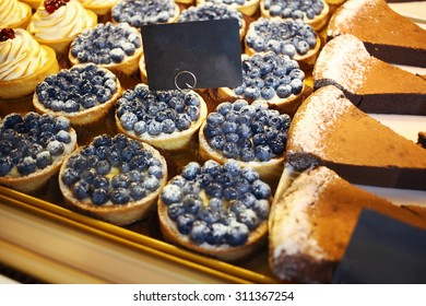 Biscuits and sweets on sale in pastry shop. Blank price tag