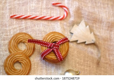 Biscuits tied with red ribbon and Christmas decorations. Top view.