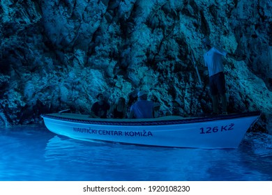 Bisevo, Croatia - Aug 16, 2020: Tourists on a boat in serene blue cave near Komiza island