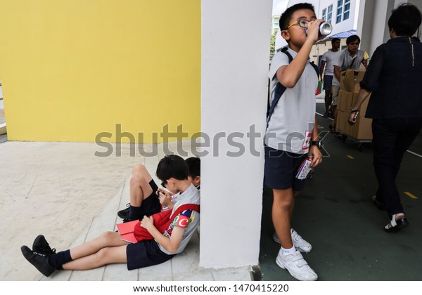 Bishan / Singapore - August 5th 2019: A young boy is waiting for his parents in the school.