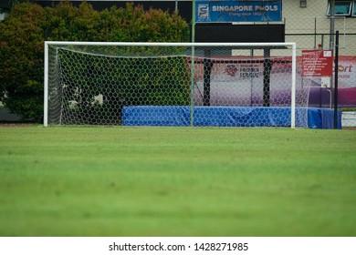 BISHAN STADIUM, SINGAPORE - 15TH JUNE 2019 - empty goalpost from the ground level