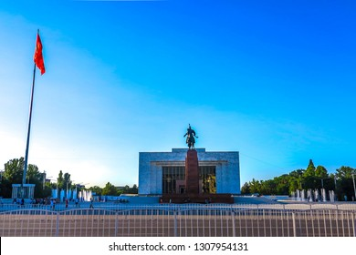 Bishkek Ala Too Square Waving Kyrgyz Flag on Flagpole with Hero Manas Statue and State History Museum View Point