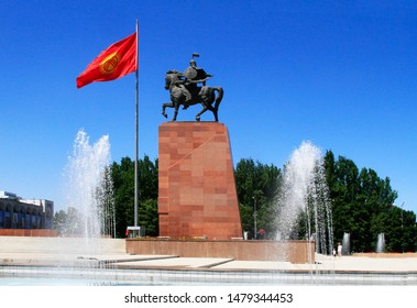 Bishkek, Chuy Province / Kyrgyzstan - May-28-2019 : Ala-Too Square with Manas statue (national hero), water jet fountains and Kyrgyzstan flag, Bishkek, Kyrgyzstan, Central Asia