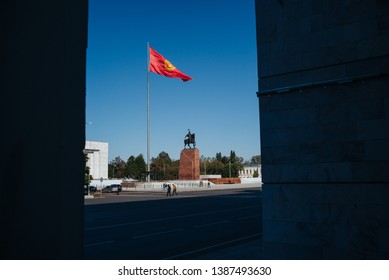 BISHKEK, KYRGYZSTAN: Ala Too Square Waving Kyrgyz Flag on Flagpole with Hero Manas Statue and State History Museum View Point