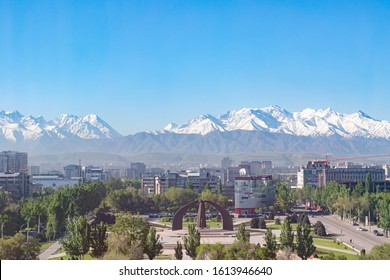 Bishkek, Kyrgyzstan - April 28, 2018: Victory square in Bishkek with on the background snow covered mountains