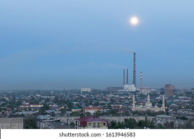 Bishkek, Kyrgyzstan - April 29, 2018: panoramic view of Bishkek on the suburb or the city, with a mosque and an industrial platform