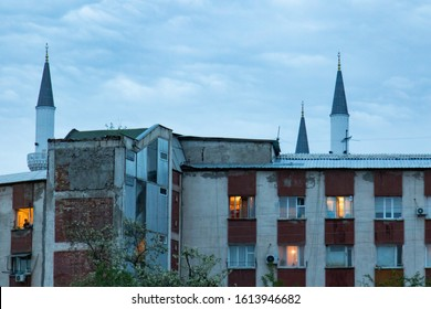 Bishkek, Kyrgyzstan - April 30, 2018: suburban buildings in Bishkek with on the background the minarets of the centrale mosque