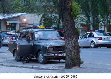 Bishkek, Kyrgyzstan - April 30, 2018: an old and rusty taxi car in Bishkek