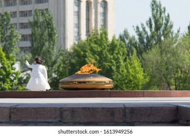 Bishkek, Kyrgyzstan - April 30, 2018: the brazied of the Victory square in Bishkek with a little girl on the background