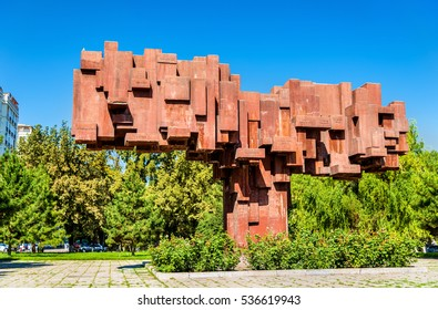 Bishkek, Kyrgyzstan - August 11, 2016: El Kutu, a monument to famous Kyrgys personalities, in Bishkek. Copper statues have been stolen and only the pedestal left.