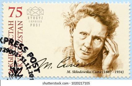 BISHKEK, KYRGYZSTAN - DECEMBER 31, 2017: A stamp printed in Kyrgyzstan shows Marie Sklodowska Curie (1867-1934), physicist and chemist, series Eminent personalities, 2017