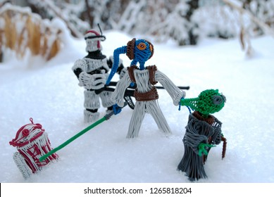 Bishkek. Kyrgyzstan. Decemer 2018. Master Yoda and one of the young twi'lek Padawan, with trooper and astrodroid R3T4. A secret operation on the cold planet Hoth. Handmade fanart.