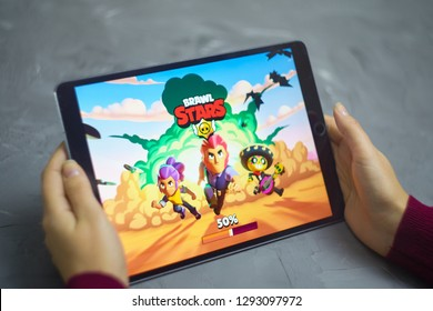 Bishkek, Kyrgyzstan - January 21, 2019: Loading screen. Girl play a free mobile game brawl stars developed and published by Supercell on ios laptop ipad pro.