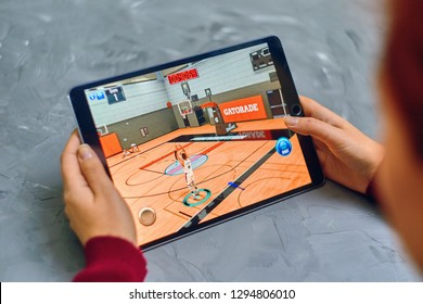 Bishkek, Kyrgyzstan - January 21, 2019: Woman plays NBA 2k mobile basketball game on ios tablet ipad pro