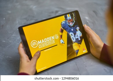 Bishkek, Kyrgyzstan - January 21, 2019: Girl playing a mobile game madden nfl of ea sports company on ipad pro