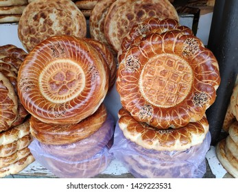 BISHKEK, KYRGYZSTAN - JUNE 20, 2019: Stand of local bread in Osh Bazaar, Bishkek, Kyrgyzstan.Traditional Kyrgyz bread named lipioshka, sold at a city bazaar.