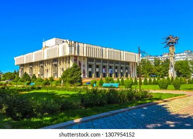 BISHKEK, KYRGYZSTAN - JUNE 2017: Kyrgyz State Philharmonic Hall Named Toktogul Satylganov with National Hero Manas Statue