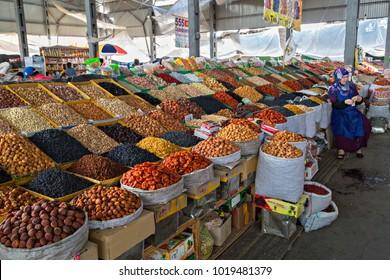 BISHKEK, KYRGYZSTAN - MAY 27, 2017: Stand of dried fruits in Osh Bazaar, Bishkek, Kyrgyzstan.