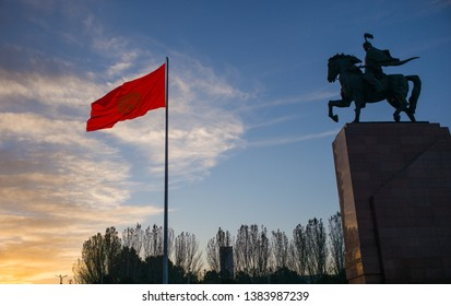 Bishkek, Kyrgyzstan: Monument for Manas, hero of ancient kyrgyz epos, together with national Kyrgyzstan flag on Bishkek central Ala-Too square