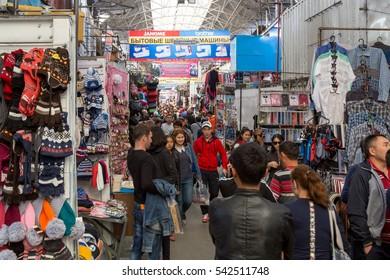 Bishkek, Kyrgyzstan - October 03, 2014: People shopping inside the huge Dordoi Bazaar