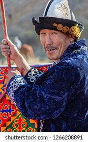 BISHKEK, KYRGYZSTAN - OCTOBER 14, 2017: Kyrgyz nomadic man builds yurt and smiles, in Bishkek area, Kyrgyzstan