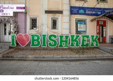 Bishkek, Kyrgyzstan - September 19, 2018 :  I Love Bishlek sign in front of travel agency and florist in Bishkek, Kyrgyzstan.