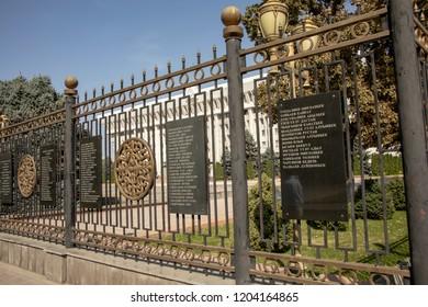 Bishkek, Kyrgyzstan - September 19, 2018 :  Names of martyrs killed in revolution on fence of White House in Bishkek, Kyrgyzstan.