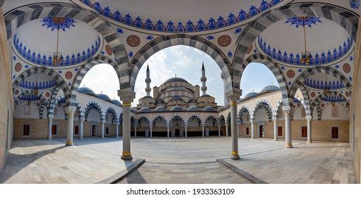 BISHKEK, KYRGYZSTAN - SEPTEMBER 28, 2019: View over the new Central Mosque of Imam Sarakhsi through the arches in its courtyard, in Bishkek, Kyrgyzstan