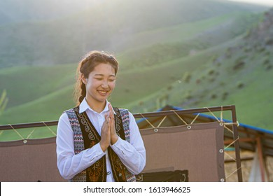 Bishkek province, Kyrgyzstan - April 28, 2018: portrait of a girl in traditional dresses dancing local music in the kyrgyz countryside