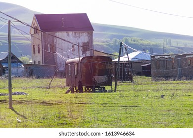 Bishkek province, Kyrgyzstan - April 28, 2018: an old and rusty train wagon in the kyrgyz countryside