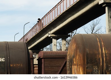 Bishkek province, Kyrgyzstan - February 24, 2017: old and rusty train wagons under a bridge, in the kyrgyz countryside