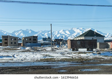 Bishkek province, Kyrgyzstan - February 24, 2017: an old and rusty train wagon in the kyrgyz countryside, with snow covered mountains on the background.