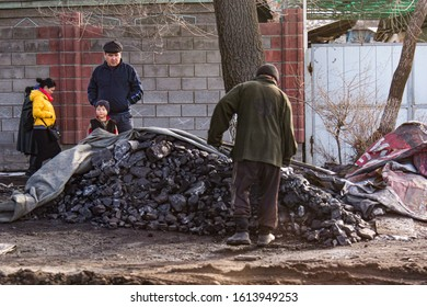 Bishkek province, Kyrgyzstan - February 24, 2017: a pile-up of peat in the kyrgyz countryside.