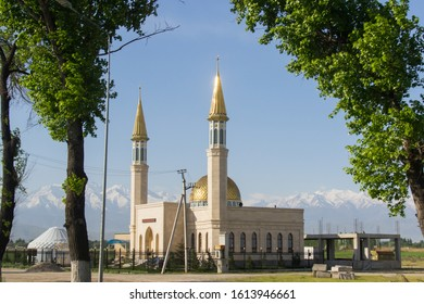 Bishkek province, Kyrgyzstan - May 6, 2018: a mosques in the kyrgyz countryside, with in the backgroun mountains covered with snow