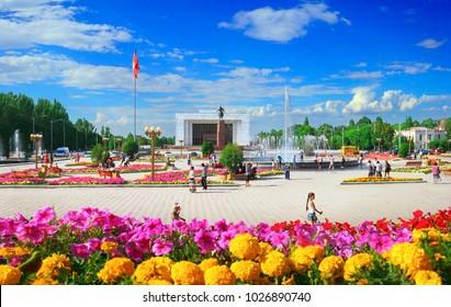 BISHKEK/KYRGYZSTAN - JUL 01: Beautiful view of Ala-Too Square, Kyrgyz Historical Museum, walking local people and blue sky on July 01, 2017 in Bishkek - the capital of Kyrgyzstan, Central Asia