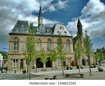 Bishop Auckland town hall. Bright sunny day, whit fluffy clouds, colourful setting. Northumberland.