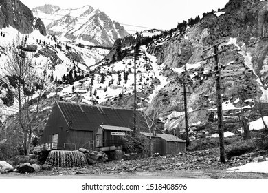 """Bishop, California - April 8 2019: The Pine Creek Mine, also known as the """"Mine in the Sky,"""" in the Eastern Sierra mountains. Black and white."""