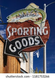 Bishop, California USA - September 14, 2018: Sporting goods store sign features a large neon rainbow trout reflecting the importance of fishing in the Owens Valley city of the Eastern Sierra.