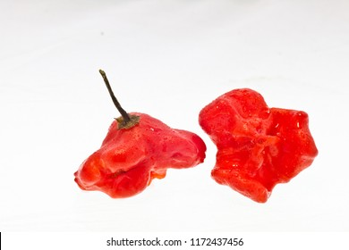 Bishops crown, christmas bell peppers, rose peppers isolated on white. Exotic breed of peppers.