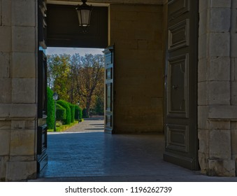 Bishop's gardens seen through town hall doors
