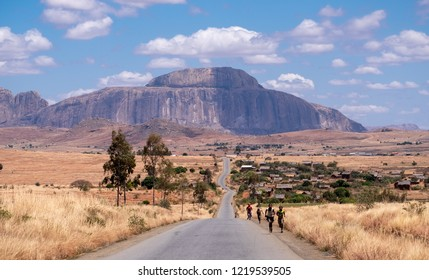 The bishop's hat mountain in Madagascar. This long road leads towards the mountain located in Madagascar's arid desert region south of the central highlands