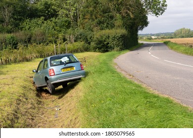 Bishop's Stortford, Hertfordshire. UK. August 29th 2020. Abandoned car in a ditch after it takes a corner too fast.