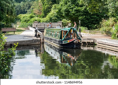 Bishops Stortford, Herts / UK - AUG 03 2018: boat passing the lock.