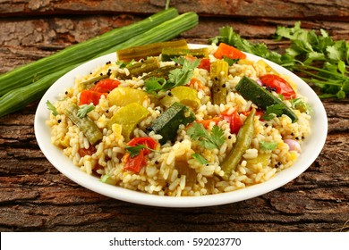 Bisi bele bhath -is a rice based dish popular in the state of Karnataka, India. Prepared with rice and vegetables.